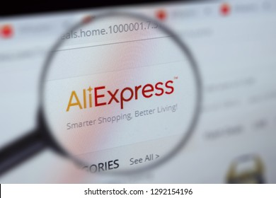 Brest, Belarus, January 22, 2019. The main page of the site Aliexpress, view through a magnifying glass. Aliexpress logo company visible. Soft focus.