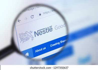 Brest, Belarus, January 22, 2019. The main page of the site Nestle, view through a magnifying glass. Nestle logo company visible. Soft focus.