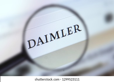 Brest, Belarus, January 22, 2019. The main page of the site Daimler, view through a magnifying glass. Daimler logo company visible. Soft focus.