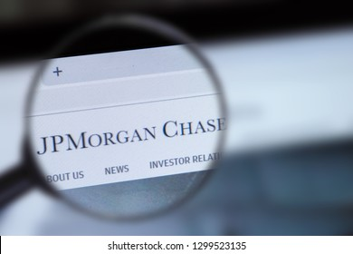 Brest, Belarus, January 22, 2019. The main page of the site JPMorgan Chase, view through a magnifying glass. JPMorgan Chase logo company visible. Soft focus.