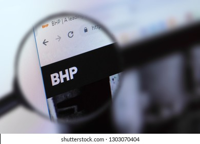 Brest, Belarus, January 22, 2019. The main page of the site BHP Billiton, view through a magnifying glass. BHP Billiton logo company visible. Soft focus.