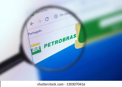 Brest, Belarus, January 22, 2019. The main page of the site Petrobras, view through a magnifying glass. Petrobras logo company visible. Soft focus.