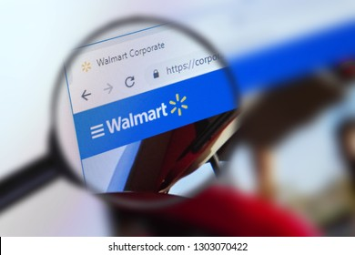 Brest, Belarus, January 22, 2019. The main page of the site Wal-Mart Stores, view through a magnifying glass. Wal-Mart Stores logo company visible. Soft focus.