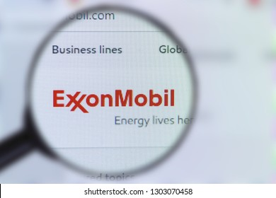Brest, Belarus, January 22, 2019. The main page of the site Exxon Mobil, view through a magnifying glass. Exxon Mobil logo company visible. Soft focus.