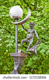 BREST, BELARUS - JULY 12, 2018: Photo of Sculptural composition Damn steals a month. Alley of wrought lanterns. Gogol street.