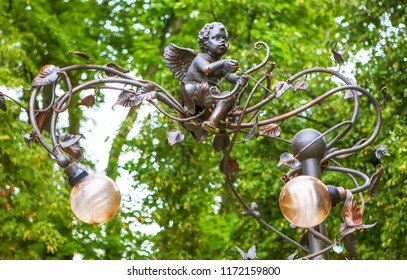 BREST, BELARUS - JULY 12, 2018: Photo of Sculptural composition Place for kisses. (Fragment). Alley of wrought lanterns. Gogol street.
