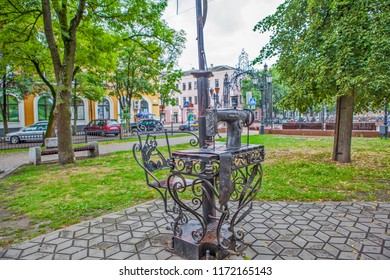 BREST, BELARUS - JULY 12, 2018: Photo of Sculptural composition Sewing machine. Alley of wrought lanterns. Gogol street.