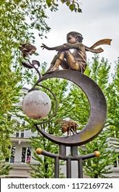 BREST, BELARUS - JULY 12, 2018: Photo of Sculptural composition Little Prince. Alley of wrought lanterns. Gogol street.
