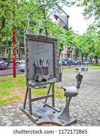 """BREST, BELARUS - JULY 12, 2018: Photo of Easel. Delicious """"still life"""" from the IP of Inco-Food LLC. Alley of wrought lanterns. Gogol street."""