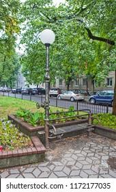 BREST, BELARUS - JULY 12, 2018: Photo of Sculptural composition Plumber. Alley of wrought lanterns. Gogol street.