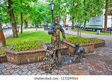 BREST, BELARUS - JULY 12, 2018: Photo of Sculptural composition The sweeper with the dog. Alley of wrought lanterns. Gogol street.