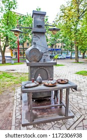 BREST, BELARUS - JULY 12, 2018: Photo of Festive table by the stove. Belalko invites. Alley of wrought lanterns. Gogol street.