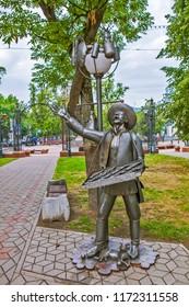 BREST, BELARUS - JULY 12, 2018: Photo of Dealer. JSC Prodtovary. Alley of wrought lanterns. Gogol street.