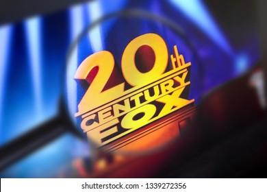 Brest, Belarus, March 15, 2019. Home page of the 20th century fox, view through a magnifying glass. 20th century fox company logo is visible. Soft focus.