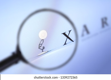 Brest, Belarus, March 15, 2019. Pixar home page, view through a magnifying glass. Pixar company logo is visible. Soft focus.