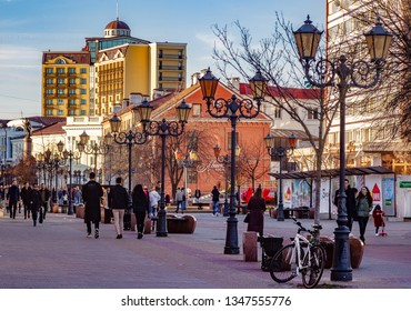 Brest, Belarus - march 23, 2019: People walking in the evening on the pedestrian street Soviet. Brest is preparing to celebrate the millennium.