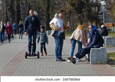Brest, Belarus - march, 29, 2020: People walk along the embankment of the river