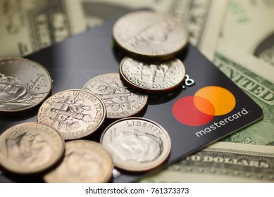 Brest, Belarus - November 23, 2017: Macro shot of Mastercard credit plastic card with new logo and dime coins