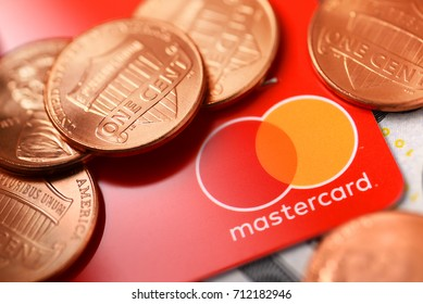 Brest, Belarus - September 9, 2017: Macro shot of Mastercard credit plastic card with new logo and penny coins