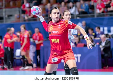 Brest, France - December 01, 2018: The handball player Neagu Cristina shoot to score during the game between Romania and Czech Republic at Handball European Championship - Preliminary Round.