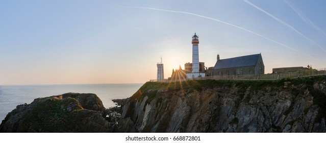 BREST harbour, Brittany FRANCE : panorama view of the Saint Mathieu lighthouse and abbey, near Le Conquet village during sunset