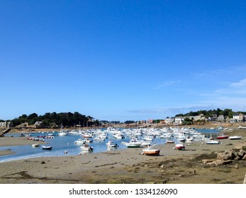 Bretagne, France - August 12, 2013: boats an yachts anchored at the small harbour in Bretagne during summer vacation