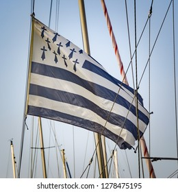 Breton flag waving in the wind on a sailing ship