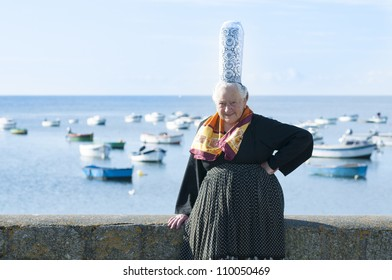 breton women with headdress bigouden posing near the sea