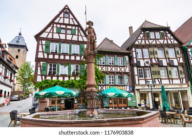 BRETTEN, GERMANY - JUNE 13, 2011: View of fountain and half-timbered houses around a marketplace in old town