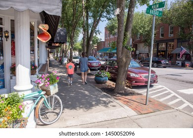 BREVARD, NC (USA) - July 7, 2019: The downtown intersection of Broad and Main Streets are lined with shops awaiting early-bird tourists on a Sunday morning.