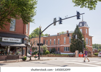 BREVARD, NC (USA) - July 7, 2019:  A view of the intersection of Main and Broad Streets in downtown Brevard with the Transylvania County Courthouse in the background.