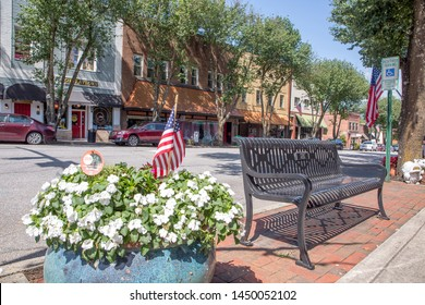 BREVARD, NC (USA) - July 7, 2019:  A view of shops lining Main Street in downtown Brevard on a quiet Sunday morning.