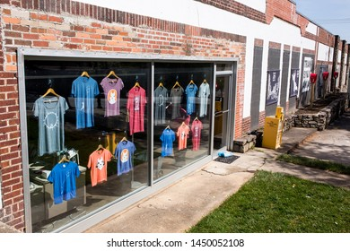 BREVARD, NC (USA) - July 7, 2019: A downtown Brevard souvenir shop displays t-shirts emblazoned with white squirrels, the town mascot.