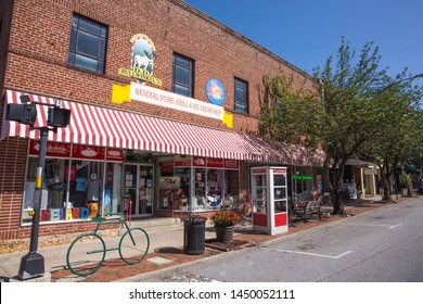 BREVARD, NC (USA) - July 7, 2019:  A row of shops on a Sunday morning in downtown Brevard, a popular mountain destination for retirees and tourists.
