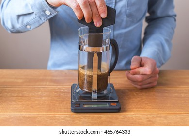 brew coffee french press, step by step. Barista coffee mixes for uniform wetting of coffee