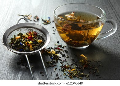Brewed delicious herbal tea on a wooden black background