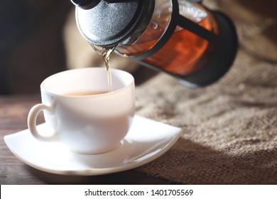 Brewed tea on a serving table with brewing
