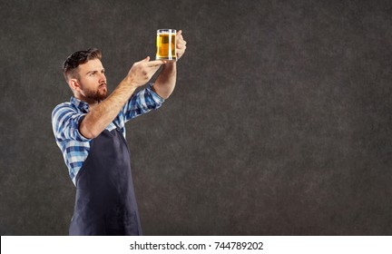 Brewer man with a glass of beer in his hand