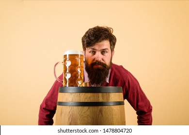 Brewer. Serious bearded man with lager beer. Equipment for preparation of beer. Brewery concept. Man tasting draft beer. Beer pub and bar. Man holds mug of beverage. Happy brewer holds glass with ale.