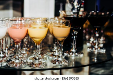 Brewery, drinks and alcohol concept, different types of beverages. Drinks in glasses on trolley ready to serve in a party.