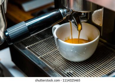 Brewing coffee from an espresso machine to a mug