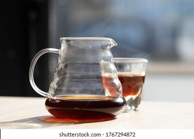 brewing coffee in a funnel. glass teapot with specialty of freshly brewed coffee. on a beautiful table, the kettle is steaming. brewing coffee. Pour Over Coffee In Funnel. Alternative Method