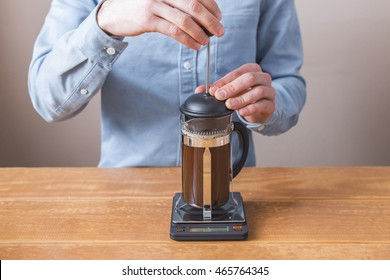 brewing coffee siphon. step by step cooking instructions. barista prepares coffee french press. waiting for brewing
