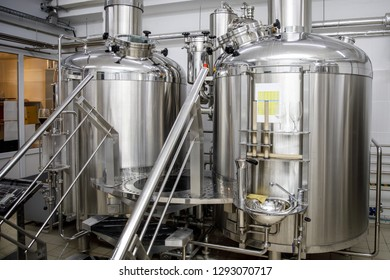 Brewing equipment. Modern brewery production steel tanks and pipes,craft beer in the microbrewery.