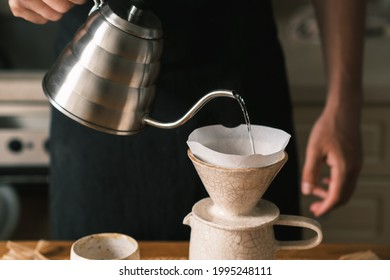 Brewing pourover coffee in the kitchen, filter coffee making pro