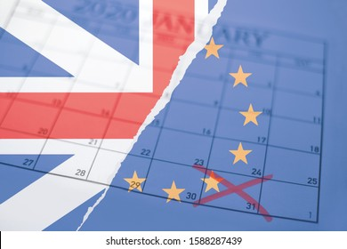 Brexit concept background with torn British Union Jack and European Union flags layered over sheet of monthly calendar with exit deadline date January 31st 2020 marked with red cross