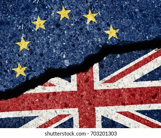 Brexit concept, crack in the wall dividing UE and GB flags