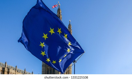 Brexit concept with European union flag juxtapositioned against Victoria tower, Westminster, London, UK.