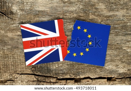Brexit concept, half blue european union EU flag on wooden background and half great britain flag. British vote to leave EU
