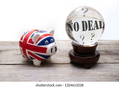 """Brexit concept for """"no deal"""" - UK money and financial system represented by a union jack piggy bank and a crystal ball"""